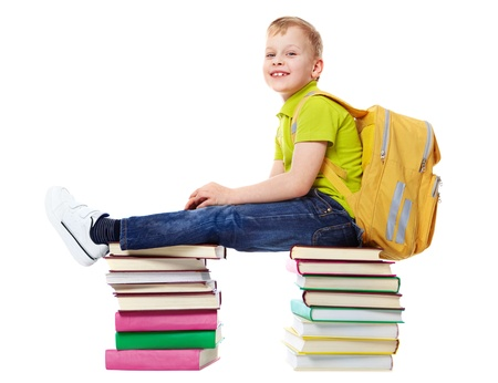 satchel: A smiling boy with satchel sitting on two heaps of books