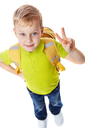 Portrait of a little boy with bag showing victory symbol photo