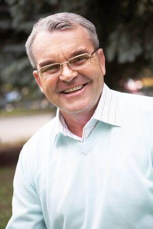 Portrait of a happy senior man photo