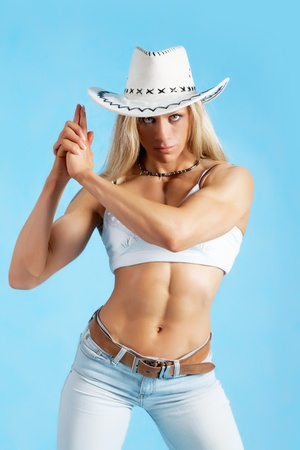 redneck: Portrait of a sexy woman in cowboy hat and jeans  Stock Photo