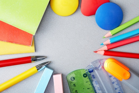 Circle of pens, pencils, chalks, rulers and exercise books  photo
