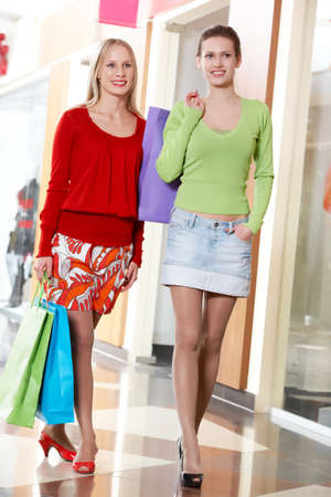 Two girls walking with shopping bags photo