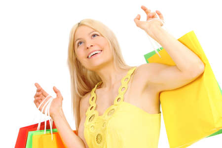 Portrait of a cheerful blonde with shopping bags  photo