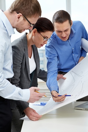 corporate airplane: Three engineers examining a sketch of plane  Stock Photo
