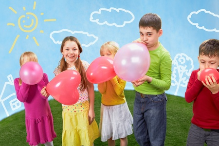 inflating: Group of happy children inflating balloons