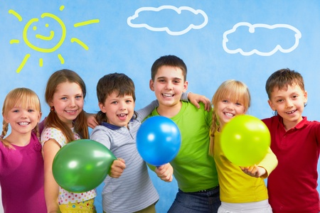 child ball: Team of children embracing each other during summer vacation   Stock Photo
