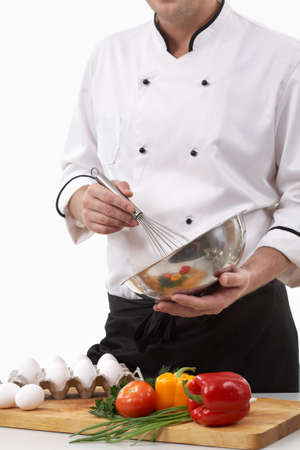 Image of a cook mixing ingredients photo