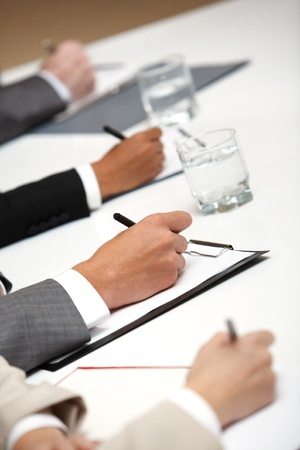 Image of four people�s hands writing Stock Photo - 9414812