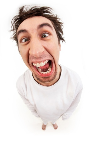 Fish eye shot of screaming insane man in strait-jacket in isolation Stock Photo - 9422582