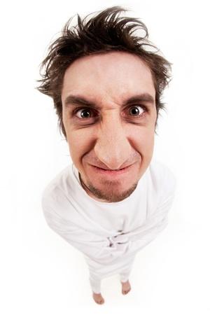 madman: Fish eye shot of screaming insane man in strait-jacket on grey background Stock Photo