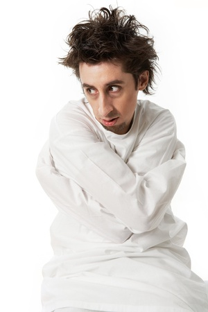 madness: Portrait of mentally ill man wearing strait-jacket in isolation Stock Photo