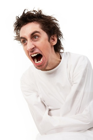 loony: Insane man in strait-jacket screaming in isolation Stock Photo