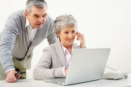 Portrait of senior woman and man working together  photo