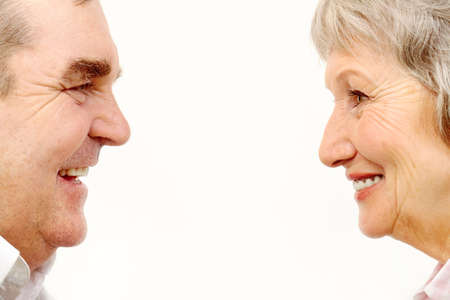 Profiles of senior woman and man face to face    photo