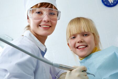 Portrait of female dentist and little girl looking at camera Stock Photo - 9455101