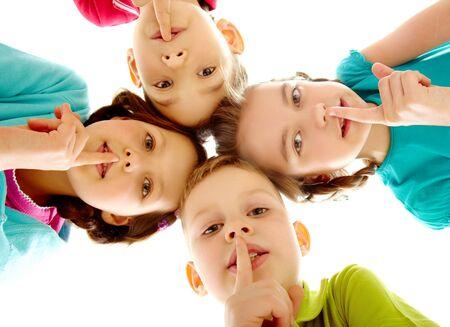 shh: Group of children fingers on lips making silence
