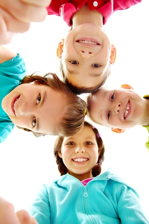 Company of four joyful children looking at camera  Stock Photo - 9494584