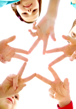 male palm: Photo of joyful children making star by their finger