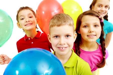 child ball: Portrait of children with balloons looking at camera  Stock Photo