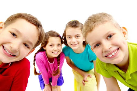Group of joyful children peeping into camera  photo