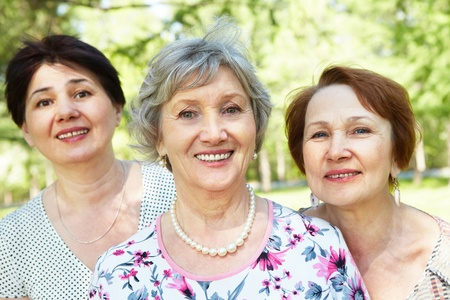 female senior adults: Group of three senior women looking at camera