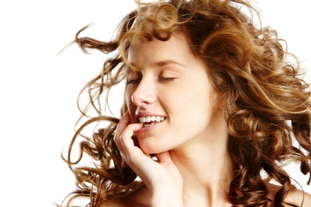 Image of beautiful young woman with curly hair photo