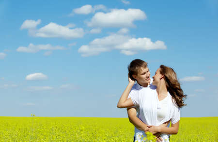 Image of happy couple in yellow meadow at summer photo