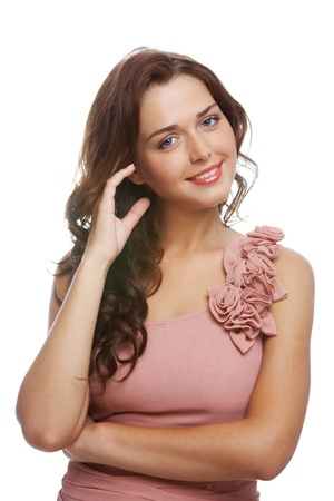 Portrait of charming woman in elegant dress looking at camera with smile photo