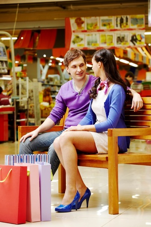 Portrait of two shopaholics chatting after shopping photo