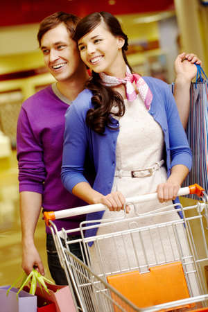 Portrait of happy couple shopping in the mall Stock Photo - 9537749