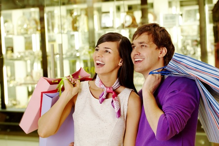 Portrait of joyful husband and wife looking at some goods in the mall Stock Photo - 9527820
