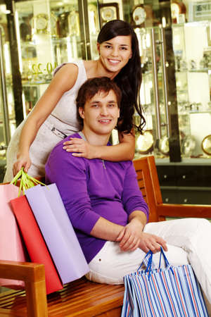 Portrait of happy couple after shopping looking at camera photo