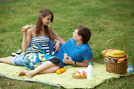Portrait of man and his girlfriend on picnic photo