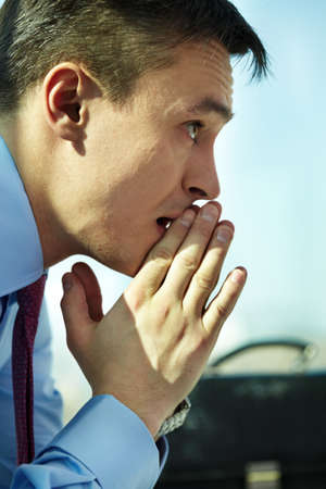 concentrating: Profile of serious man concentrating on thoughts Stock Photo