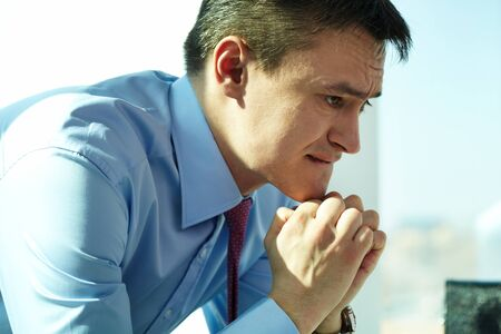 Image of serious man concentrating on thoughts photo