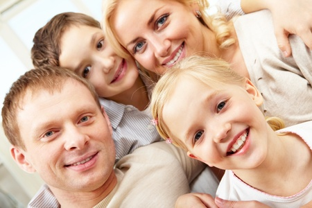 Close-up of a smiling family of four Stock Photo - 9571825