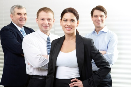 A business team of four looking at camera and smiling Stock Photo - 9571789