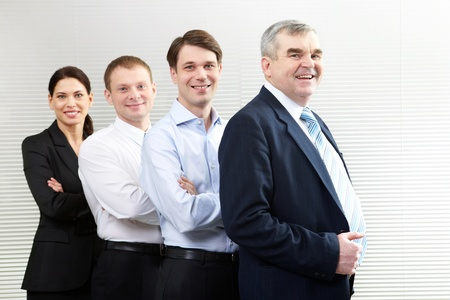 Portrait of a business team of four looking at camera and smiling  Stock Photo - 9571843