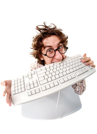 mordendo: High angle view of a tousled man biting keyboard Imagens