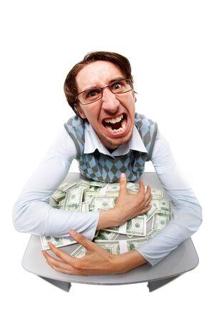 Portrait of a greedy man hiding his money  photo