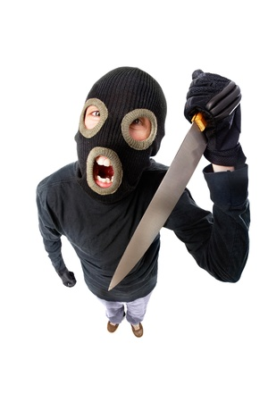 Fish-eye shot of a criminal in mask holding knife photo