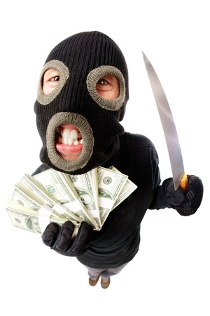 outrageous: Fish-eye shot of a criminal in mask holding knife and money