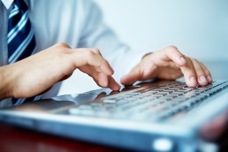 Close-up of male hands typing on laptop keyboard  Stock Photo - 9571853