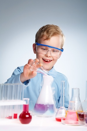 An enthusiastic boy looking at the results of his experiment photo