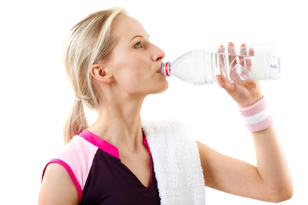 Portrait of a training woman drinking water photo