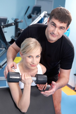 A man helping a woman with exercises  photo