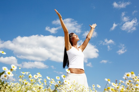 Image of happy female standing with raised arms on summer day Stock Photo - 9571932