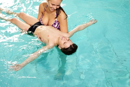 Photo of mother holding her son in swimming pool  photo