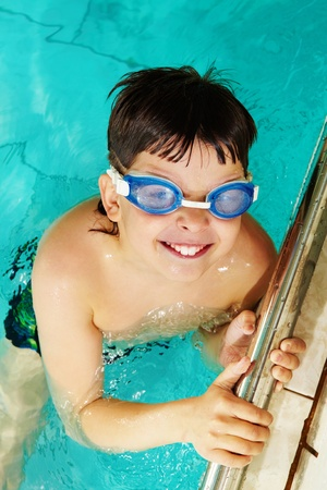 Photo of happy lad in goggles smiling at camera  photo