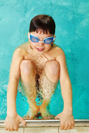 lad: Photo of happy lad in goggles in swimming pool  Stock Photo
